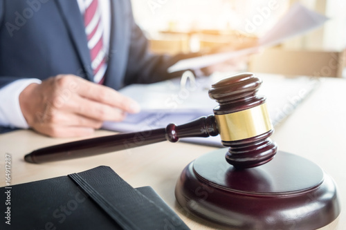 gavel and sound block of justice law and lawyer working on wooden desk backgroun Slika na platnu