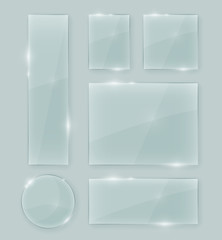 Fototapeta Transparent vector crystal clear glass shapes. Shiny realistic glass texture design elements collection with transparency.