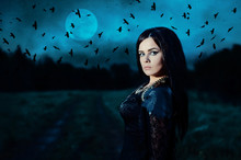 A Young Witch On Background Of...