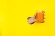 Leinwandbild Motiv Crop hand holding glass of juice