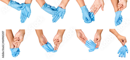 Step of hand throwing away blue disposable gloves. Wallpaper Mural