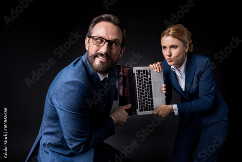 Excited Mature Coworkers Fighting For Laptop With Blank Screen Isolated On Black Buy This Stock Photo And Explore Similar Images At Adobe Stock Adobe Stock