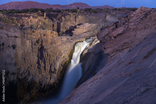Foto op Aluminium Aubergine Main Augrabies waterfall after sunset, lighted by electric light