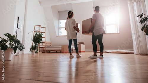 Young couple moving in new house Canvas Print