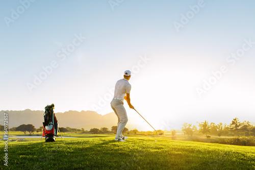 Deurstickers Golf Professional male golfer taking shot on golf course