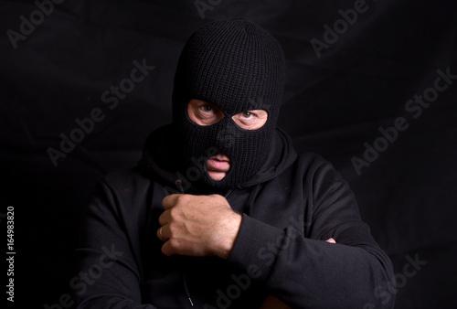 Horizontal image of a threatening man with a balaclava mask Canvas Print
