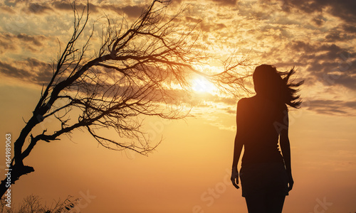 Fotografie, Obraz  Lonely Woman at the sunrise