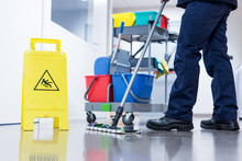 Worker Janitor Mopping Floor I...