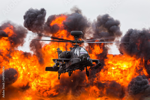 Army Air Corps WAH-64D Apache in front of a wall of fire Wallpaper Mural