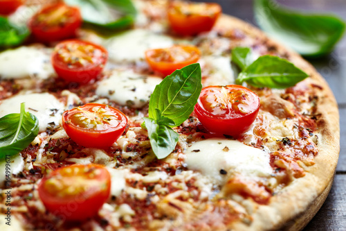 Pizza with mozzarella and cherry tomatoes