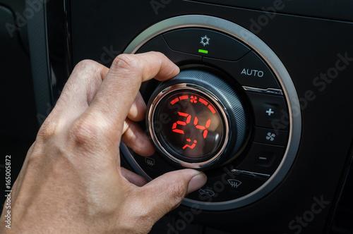 Adjust air conditioner in car , Driver hand tuning temperature control in car ai Canvas Print