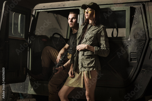 Women and men standing near tank. Fototapet