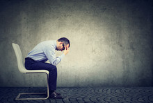 Sad Stressed Businessman Sitti...