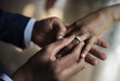 canvas print picture - Groom Put on Wedding Ring Bride Hand