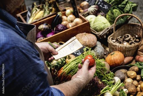 Man buying fresh organic vegetable at market Fototapeta