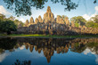 The spectacular reflection of Bayon a mountain temple built to represent Mount Meru, the center of the universe in Hindu and Buddhist cosmology, Siem Reap of Cambodia.
