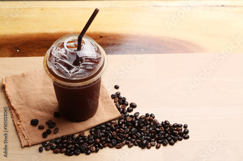 Photo Stands Coffee beans Ice americano , Black coffee and coffee beans