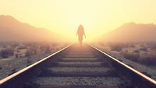 Young Man Walking On Railroad