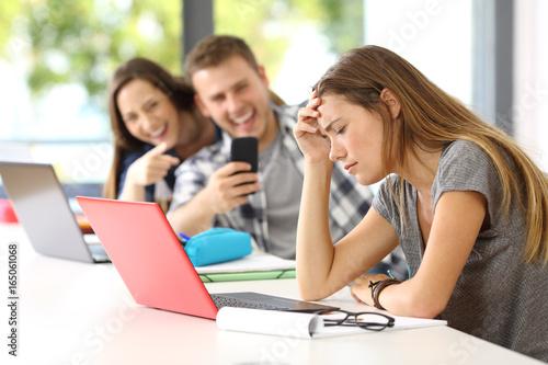 Fotografie, Obraz  Sad student victim of cyber bullying