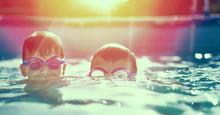 Two Little Kids In Goggles Swi...