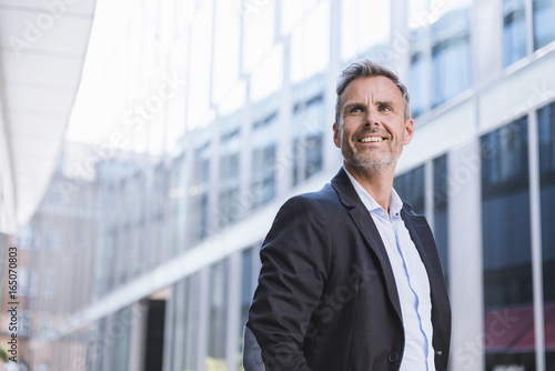 Portrait of smiling businessman in the city