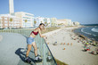 Young woman on inline skates looking at the beach