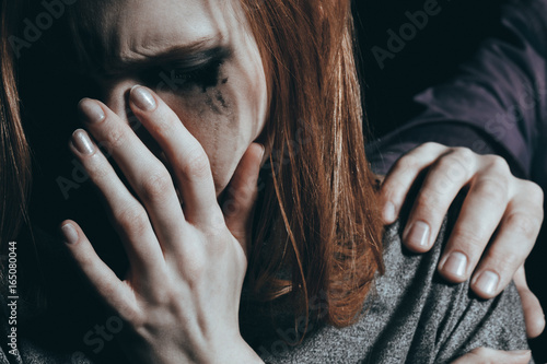 Cuadros en Lienzo  Crying girl with depression being comforted by men