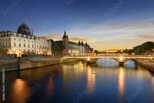 Tablou Canvas Boat tour on Seine river in Paris with sunset. Paris, France