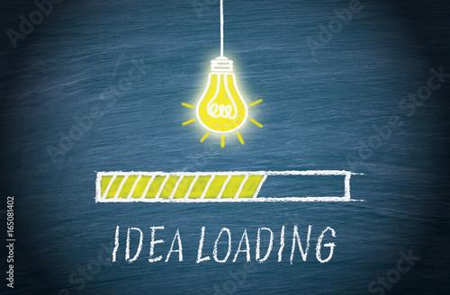 Great Idea loading, light bulb concept on blue background Canvas Print