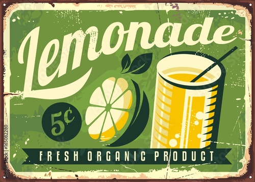 Lemonade vintage tin sign. Retro advertisement with lemon slice and glass of fresh lemonade.
