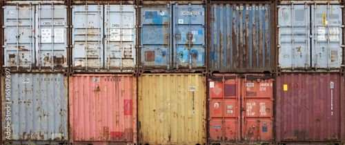 Fotografie, Obraz  Stack of colourful and rusty containers in the port of Antwerp