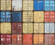 Stack Of Colourful And Rusty Containers In The Port Of Antwerp.