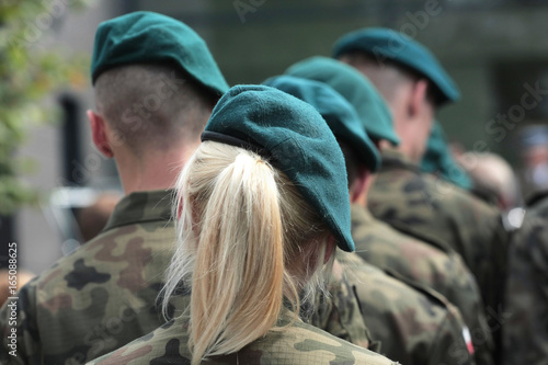 A Number Of Soldiers In Uniforms Of The Polish Army Including A