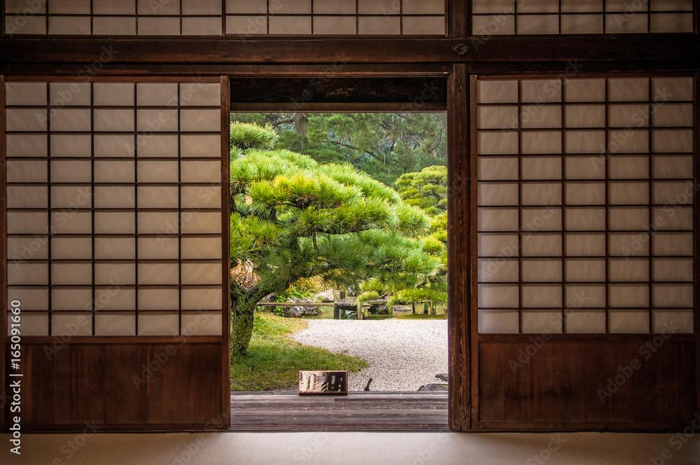 Japanese garden seen through sliding door.