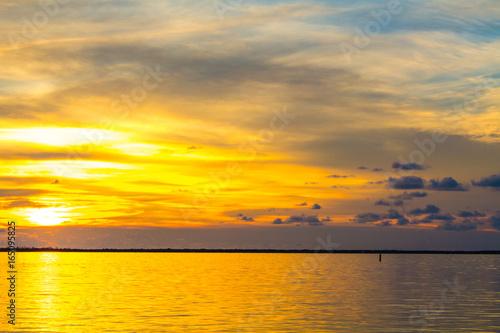 Poster Melon Sunset above ocean.