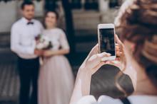 Woman Taking Photo On Phone Of...