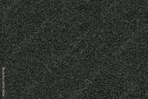 Fotografering seamless texture of black sponge or foam