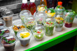 Tasty healthy food in cups on green counter