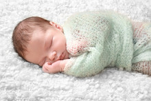Sleeping Newborn Baby Boy On S...