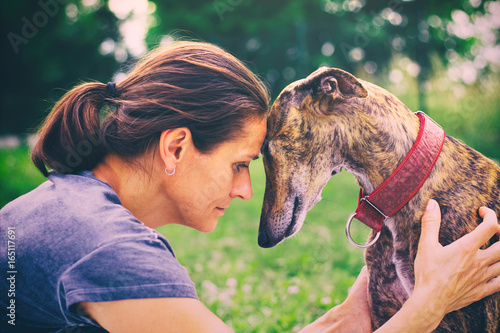 Friendship between woman and her dog. Canvas Print