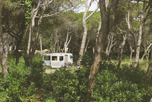 Old And Abandoned Caravan On Forest.