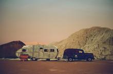 Vintage Car And Trailer In A Dusky Desert Landscape