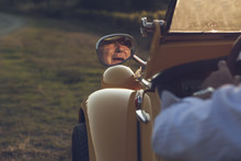 Senior Man Driving A Cabriolet, His Face Is Reflected In The Mirror Of The Car