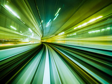 Motion Blur Train Moving In City Rail Tunnel.