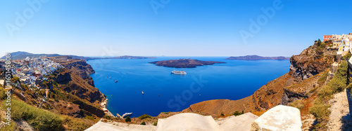 Tuinposter Athene Panorama of colorful houses in Fira town, and view on caldera Santorini island