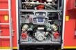Feuerwehrausrüstung / Wasserpumpe und Zubehör auf einem Feuerwehrfahrzeug