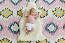 Newborn Laying On A Sheepskin ...