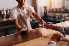 Customer Paying Through Credit Card At Coffee Shop