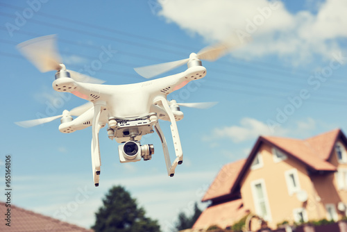 Fototapeta drone usage. private property protection or real estate check obraz