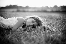 Girl Laying In A Field Of Clov...